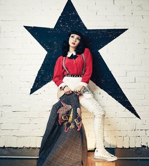 CL wearing Depuis 1924 vintage Versace suspenders